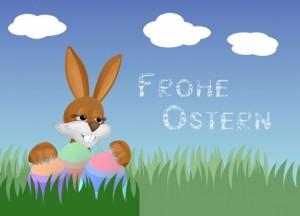 Osterhase beim Verstecken der Eier im Gras